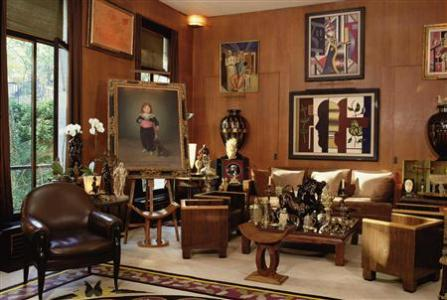 General view of a Pierre Berge's living room with paintings which will be auction by the Christie's auction house and presented at a news conference in Paris