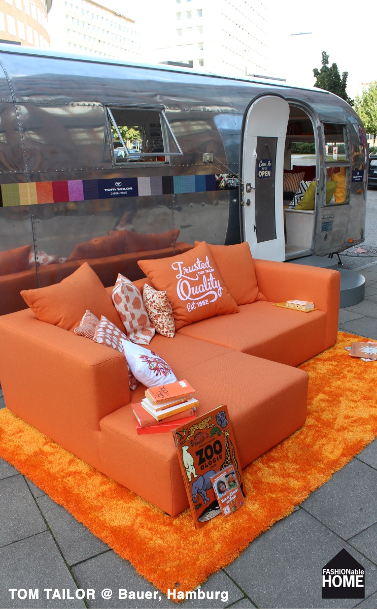 Orange TOM TAILOR Sofa & Airstream on tour