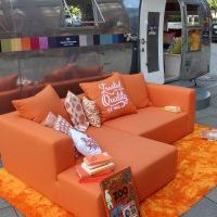 Orange TOM TAILOR Sofa & Airstream on tour